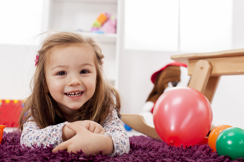 Girl on floor with balloons