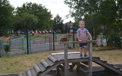 Boy in outdoor area at Happy Kids Delamere Park Day Nursery in Higher Openshaw, Manchester