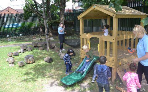 Children enjoying the garden at Happy Kids Heybury Close, Manchester Day Nursery