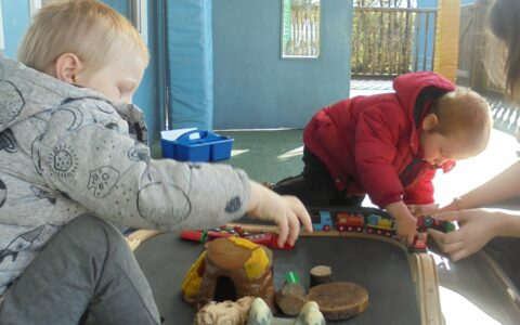 Boys playing with train at Happy Kids Thrybergh, Rotherham