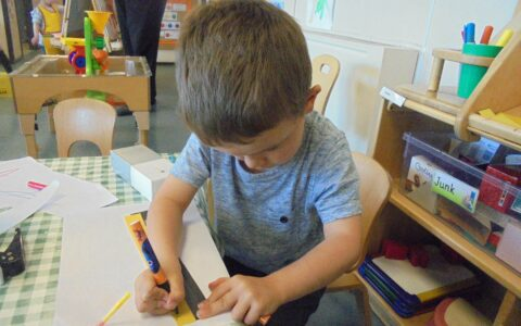 Boy drawing at Happy Kids Thrybergh, Rotherham